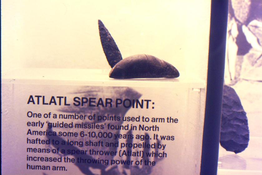 spear point with throwing stick weight