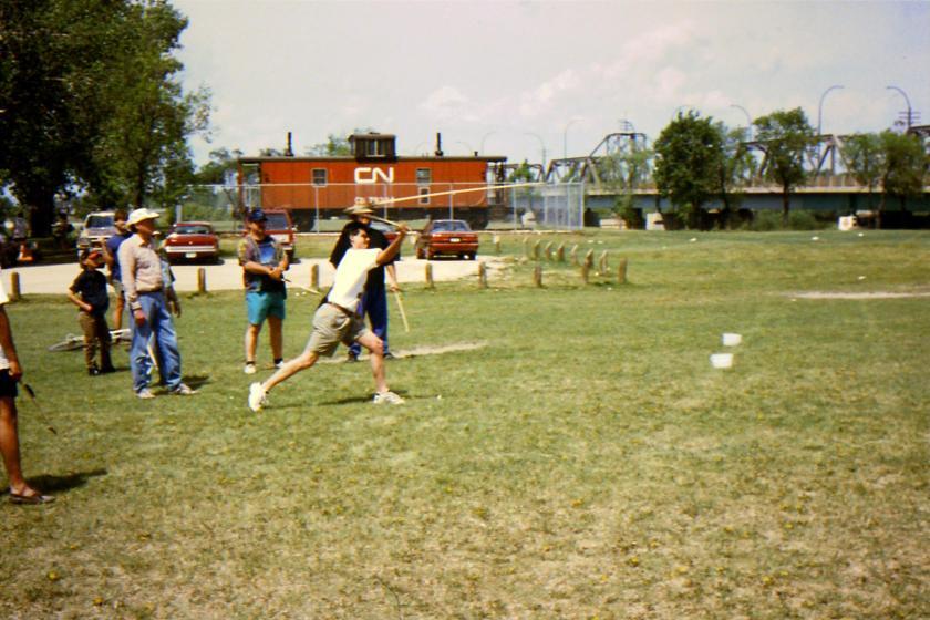 participant launching atlatl dart